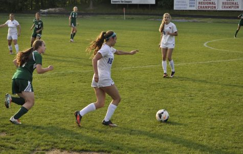 Soccer one win away from playoffs