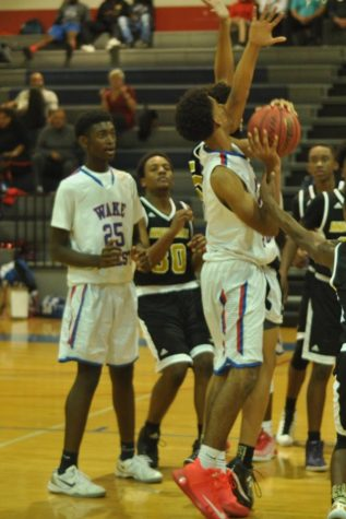 Varsity basketball looks to close out final year in Cap-8