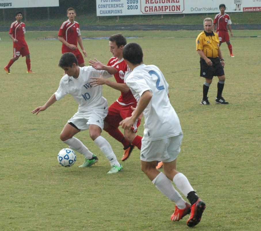 All-region center midfielder Zach Morris battles for possession with a Franklinton defender while sophomore Dylan Chain watches on. Morris has 15 assists and one goal for the season.