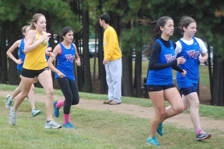 Junior Leah Weber (front right) and seniors Brooke MacKenzie (front left) and Elizabeth Prosser compete in the Oct. 9 race against Enloe. All three finished ahead of the 2nd through 6th Enloe runners.