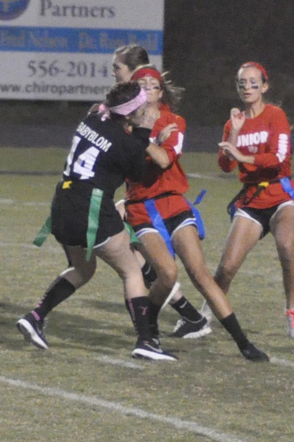 Senior Amanda Blomberg collides with junior Audrie-Emma Bruce during a pass play.