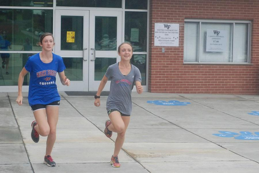 Erin Mercer (left) and Kayla Holder (right), first runner at XC State Championship since 2004.