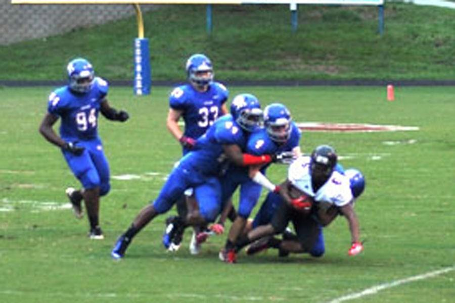 Cougar defenders swarm a Rolesville Ram opponent Sept. 12. The Cougars defeated the rams 61-20.