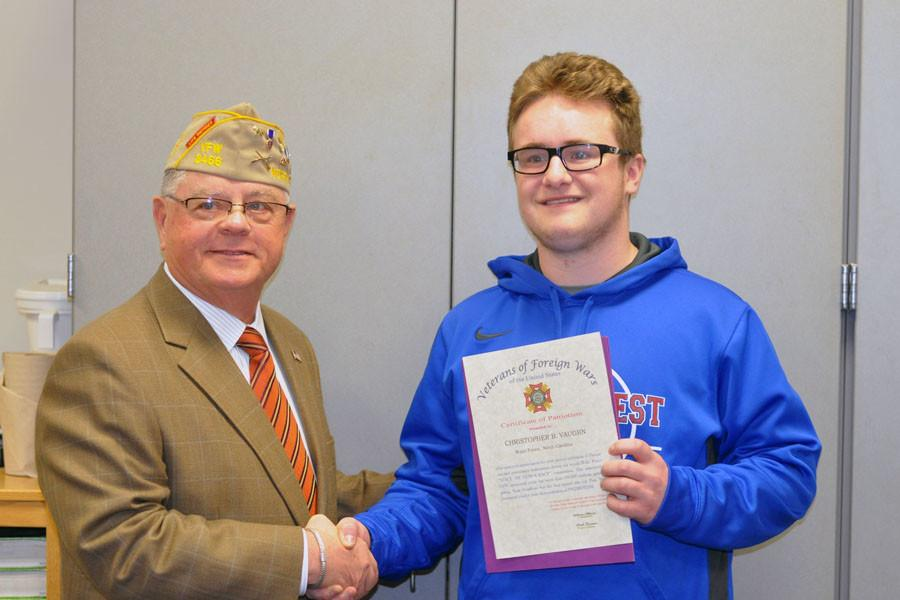 Chris Vaughn accepted the Voices of Democracy scholarship Jan. 26 from a representative of the VFW. Vaughn received an amount of $150 and is eligible to compete at the state level.