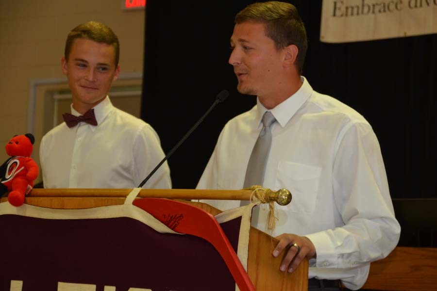 Senior+Connor+Cochrane+looks+on+as+his+coach%2C+Mike+Atkinson%2C+speaks+before+the+Raleigh+Sports+Club.+Cochrane+was+named+the+Athlete+of+the+Week+Sept.+16.