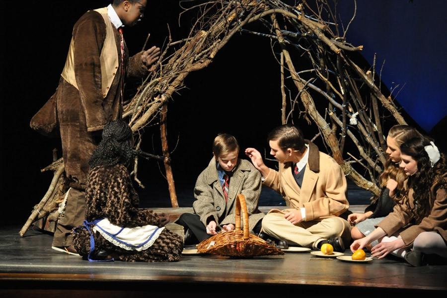 Sophomore+Andrew+Ross+%28center+right%29+places+a+consoling+hand+on+freshman+Caleb+Wrights+shoulder.+Ross+played+Peter+Pevensie+while+Wright+played+his+sibling%2C+Edmund+Pevensie.+