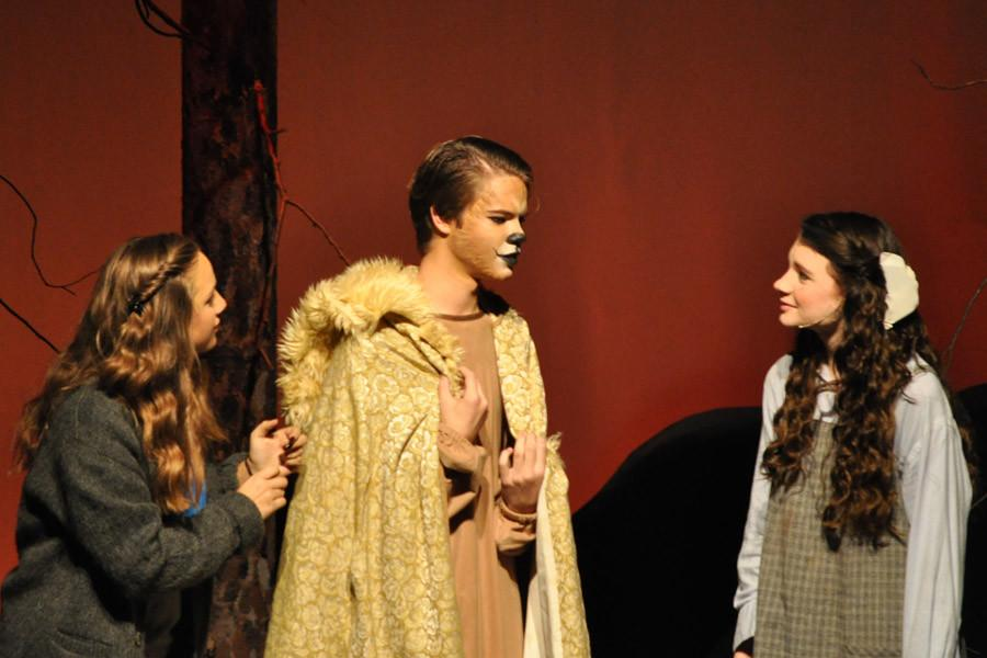 Sophomore April Houghland (right) as Lucy Pevensie and freshman Carly Hebert (left) listen to the character of Aslan.