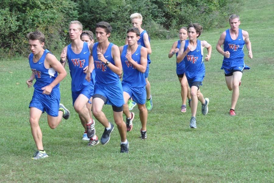 The boys compete in a dual meet against Heritage Sept. 22. John Autry leads Markian Kuropas, Joseph Lawhorn and Bailey Autry.