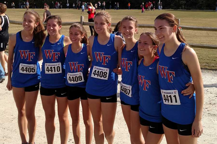 The girls' cross country team pose at the NCHSAA regional meet Oct. 31. The girls took the last qualifying slot from Broughton to be able to attend the state meet Nov. 7.