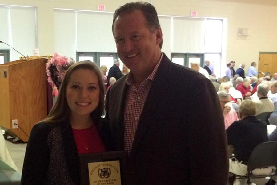 Senior Leslie Blalock poses with NC State Men's Basketball coach Mark Gottfried Nov. 4 when she was honored by the Raleigh Sports Club as its high school athlete of the week.