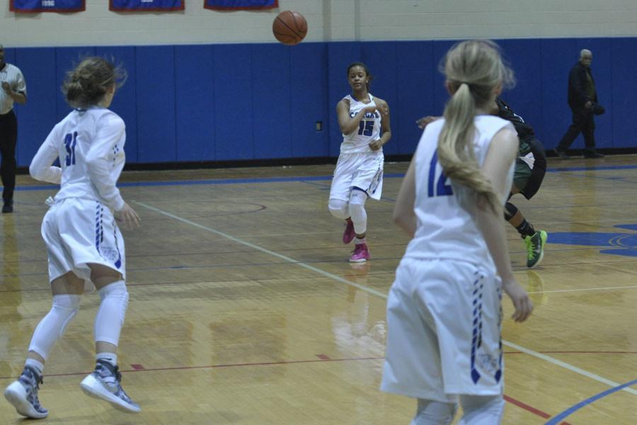 Sophomore Jada Miller passes to sophomore teammate Kayla Surles Dec. 3.