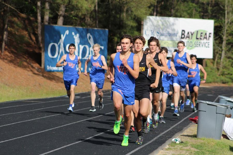 Senior+Bailey+Autry+leads+the+pack+against+Broughton.+This+photo+is+not+from+the+Wake+County+track+meet.
