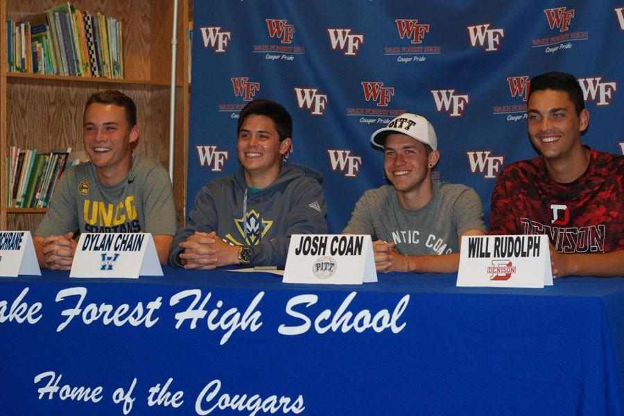 Seniors Josh Coan, Connor Cochrane, Dylan Chain, and Will Rudolph display the colleges they have chosen. All four are excited and hopeful for the future.