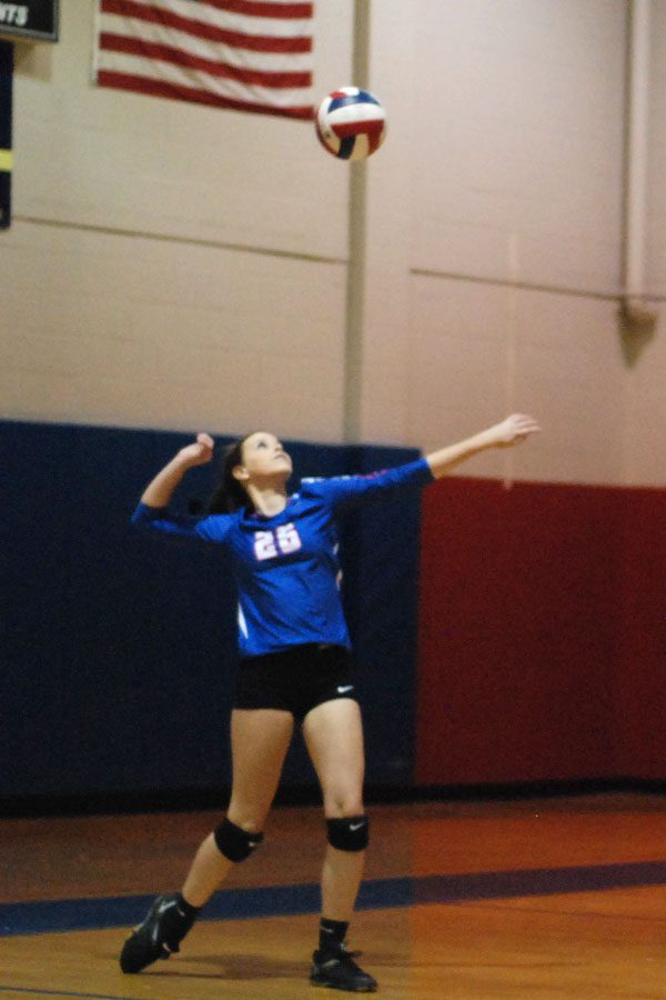Kyla Hunter serves the ball in a match against Rolesville.