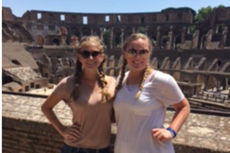 Seniors Jules Micchia and Grace Skipper appreciate the scenery of the Colosseum in Rome, Italy.