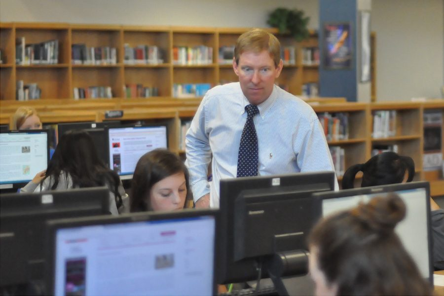 Randy Olund assists students as the new media specialist. Olund previously worked as a Media Specialist in  Wakefield Ninth Grade Center