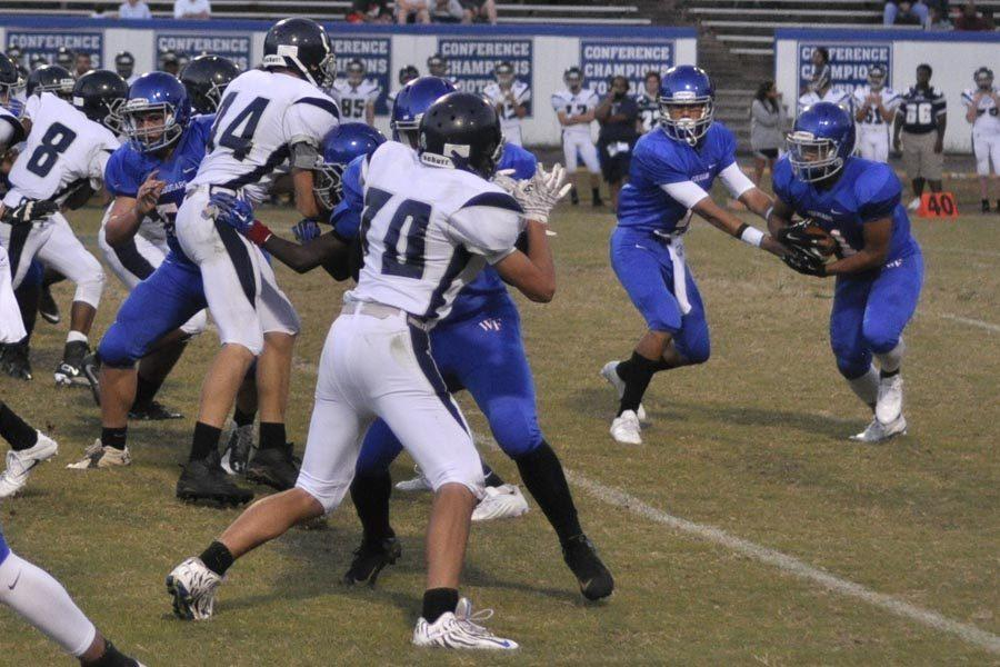 JV football team takes Cap-8 again