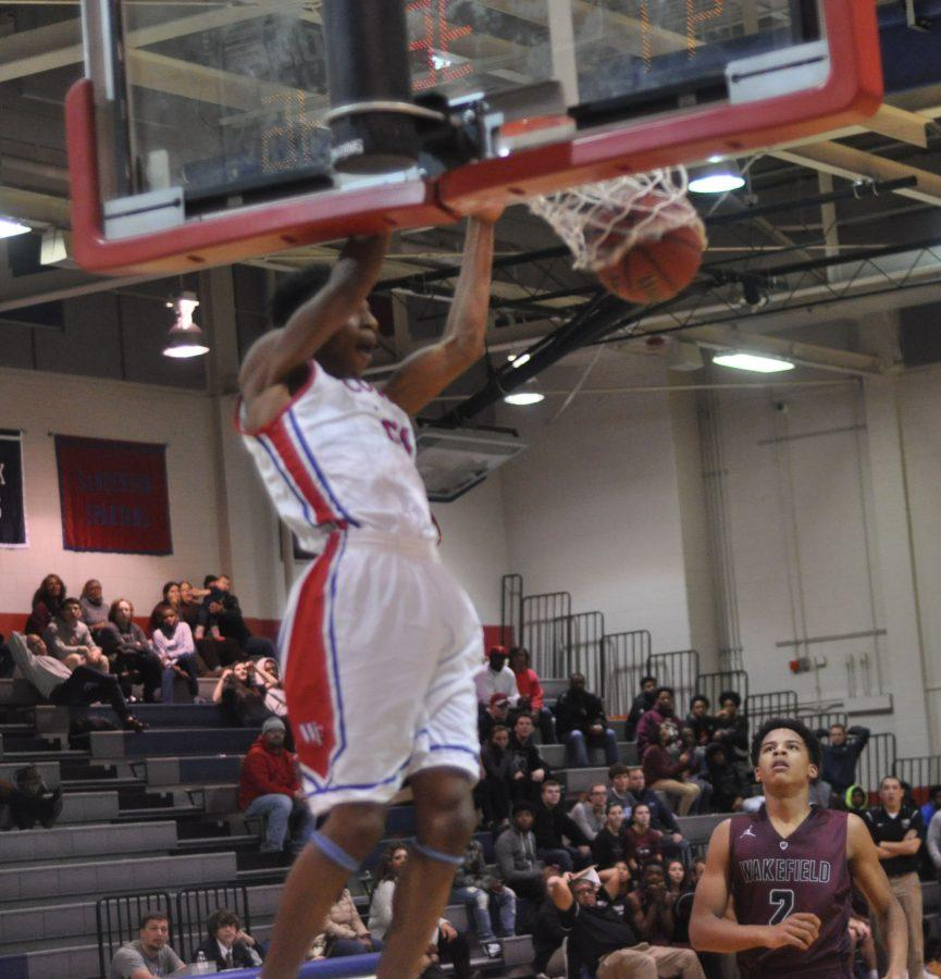 Isaiah Jones dunks at the Wakefield Varsity Basketball game.