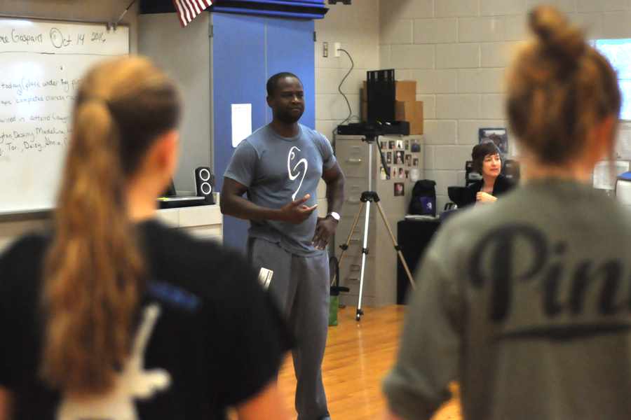 Dance instructor Gaspard Louis visited Sherri Newhouse's classes and taught students weight sharing techniques.
