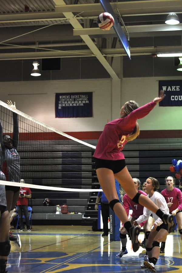 Sophomore Ramsey Schlafer goes up for the kill as she's backed by her team.