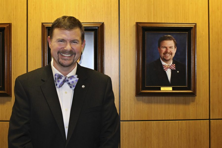 Town Commissioner Jim Thompson with his portrait. Thompson is running for Mayor in the 2017 election.