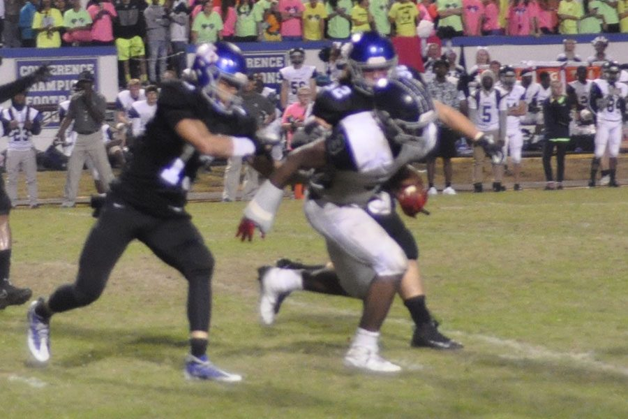 2016 state championship game defensive MVP, #13 Seth Williams and #13 Lex Goodwin pursue leading Husky rusher and NC State commit Ricky Person.