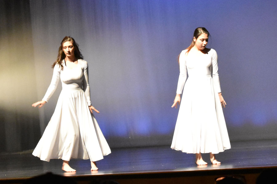 Juniors Hailey Germann (left) and Rachel Cheeseman (right) perform during the May 11 dance concert. Cheeseman favors lyrical and contemporary dance while Germann cites modern dance as her favorite.