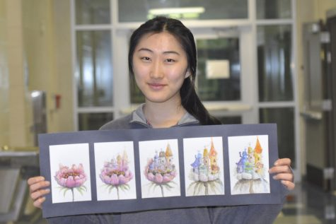 Senior Anna Kim poses with her metamorphosis project. In this project, she had to combine an organic object (a flower) with an inorganic object (a castle). The picture showed the transformation of how a flower became a castle through five stages.