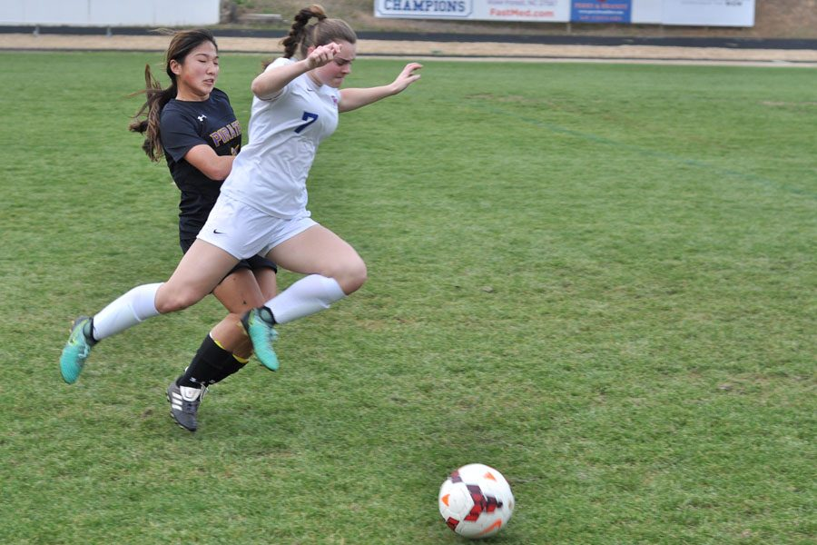 Forward/Midfielder Hannah Dion surges past a Corinth Holders defender during a home conference game. Dion led the team in scoring three of her four seasons.