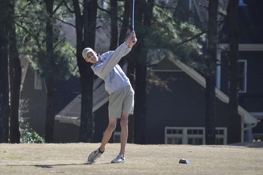 Junior Zac Hickey competes during a regular season match. The team qualified for regional play.
