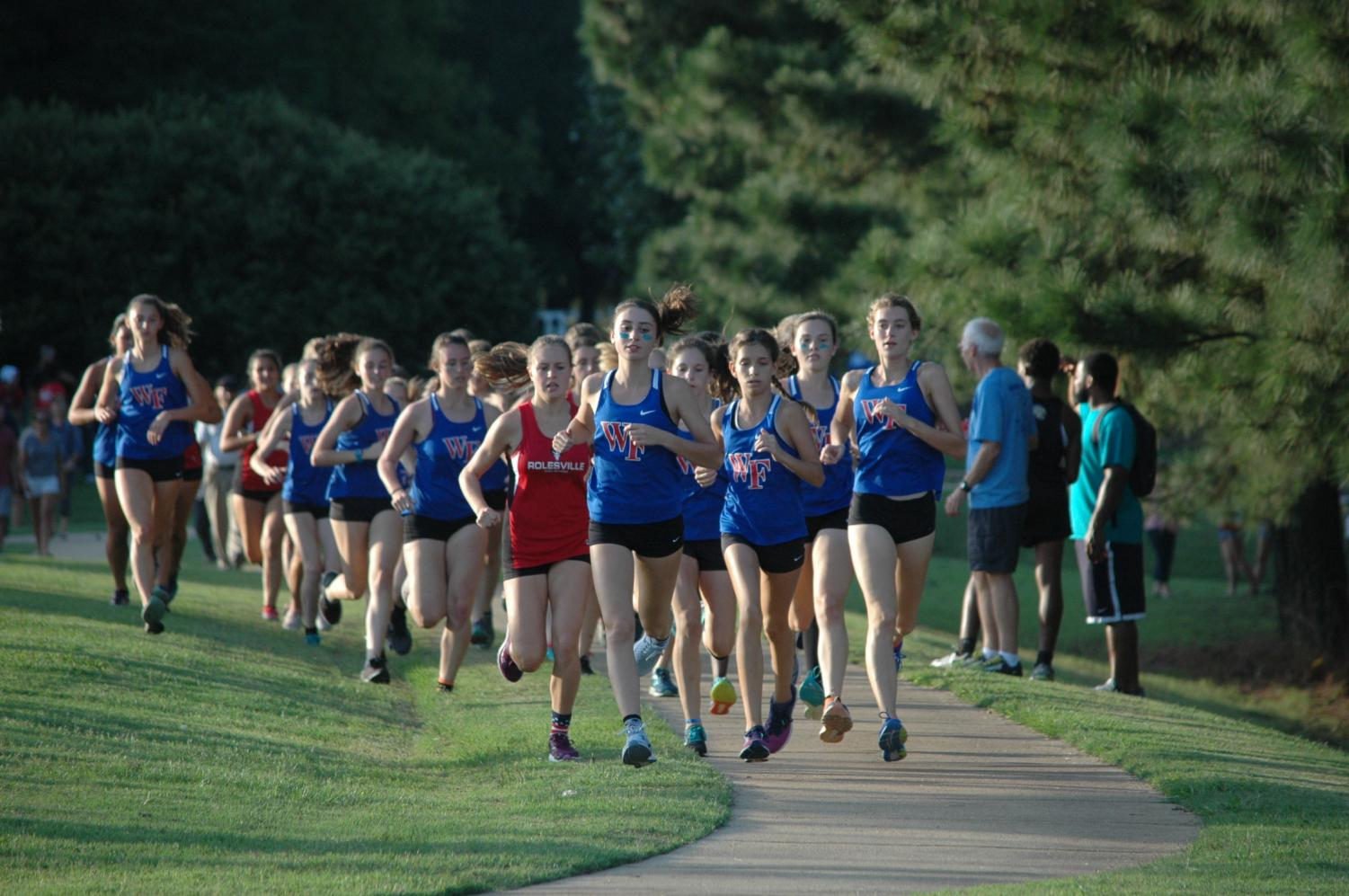 Senior Erin Spreen leads the pack on senior night in the fall cross country sports season. Later that spring track season, Spreen would set the school record in the 1600m run.