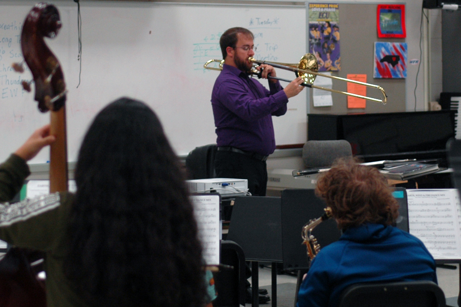 Martel leads his instrumental music class.