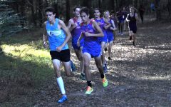 Navigation to Story: Boys' Cross Country Takes Conference Title
