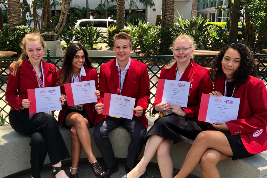 FCCLA+seniors+Rachel+Giles+%28left%29+and+Rachel+Manukas+%28second+from+left%29+place+first+in+the+national+competition.+